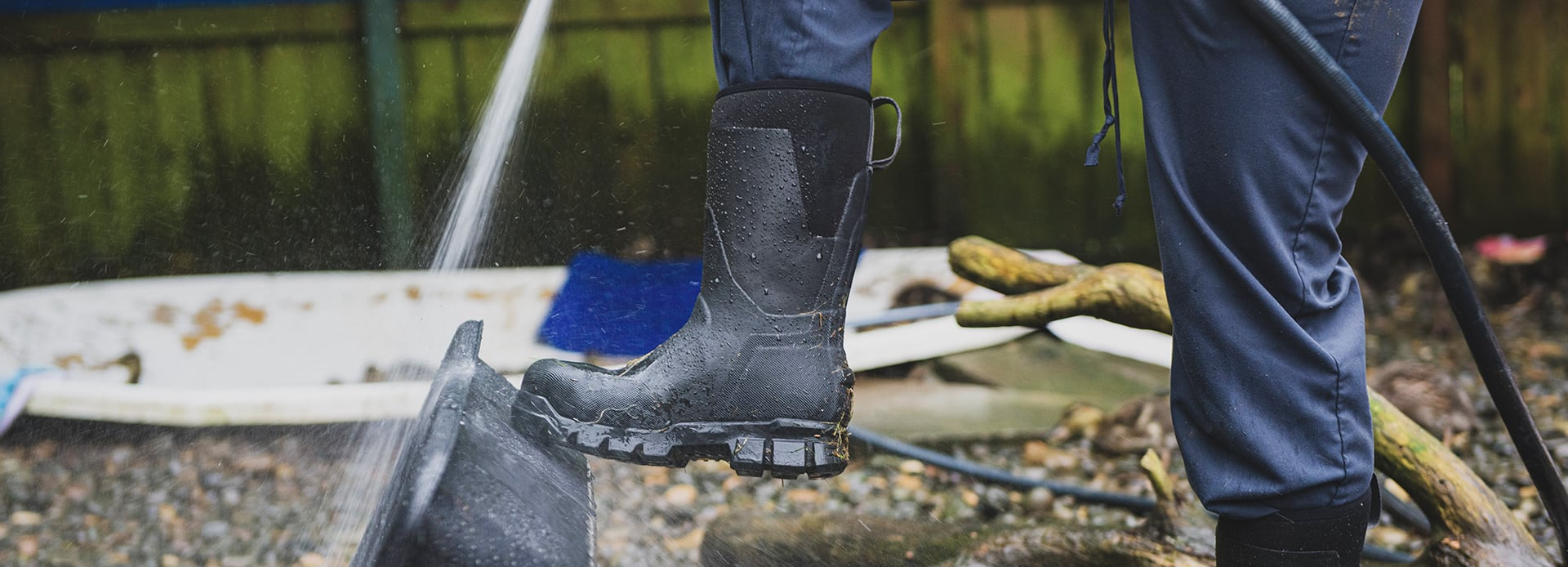 A person working in wet conditions, wearing CAT stormer boots