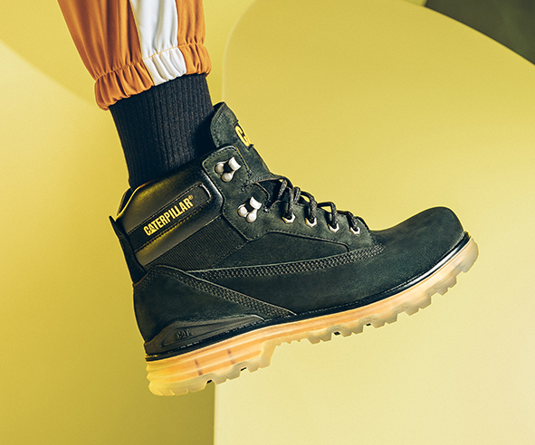 CAT Boot against a yellow backgorund highlighting the Visitech baseplate.
