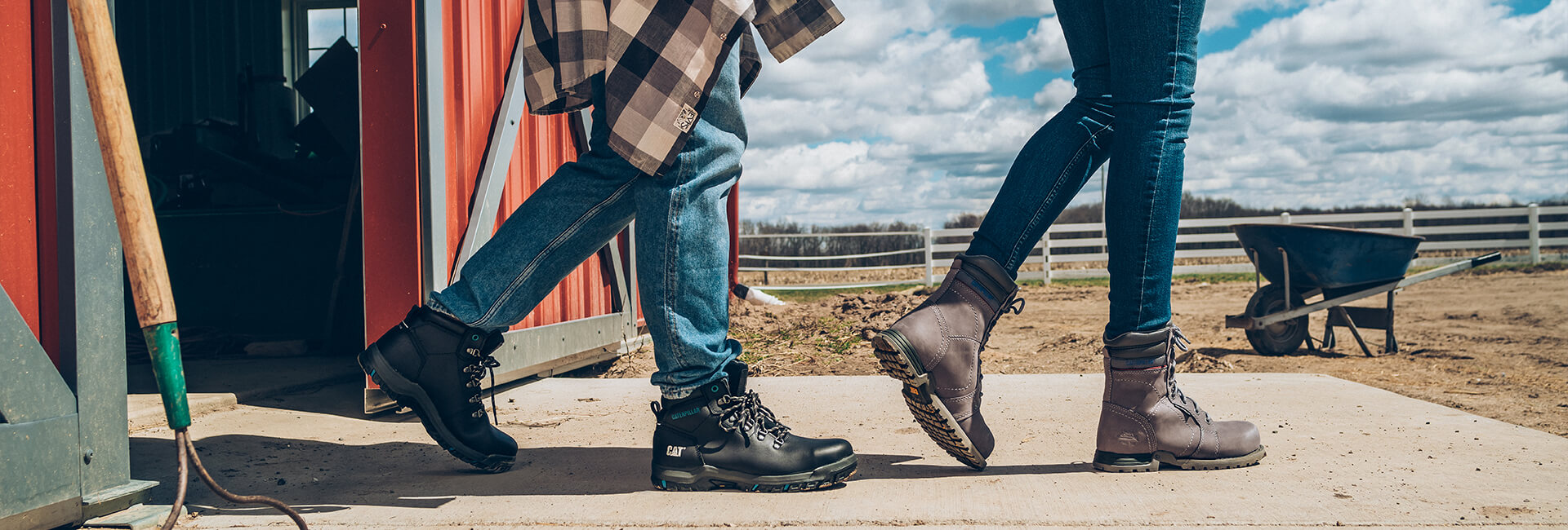 Two people walk out of a barn (not a joke). We only see them from the knees down, but what is not in dispute is that they have some sweet boots!