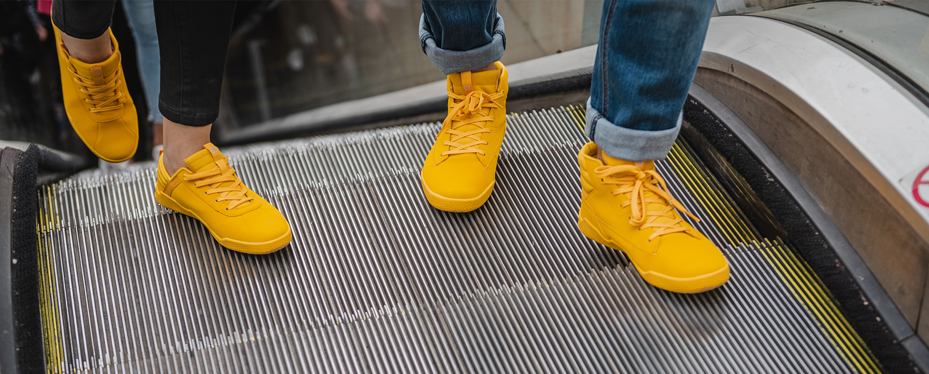 Cat Code Shoes on an escalator