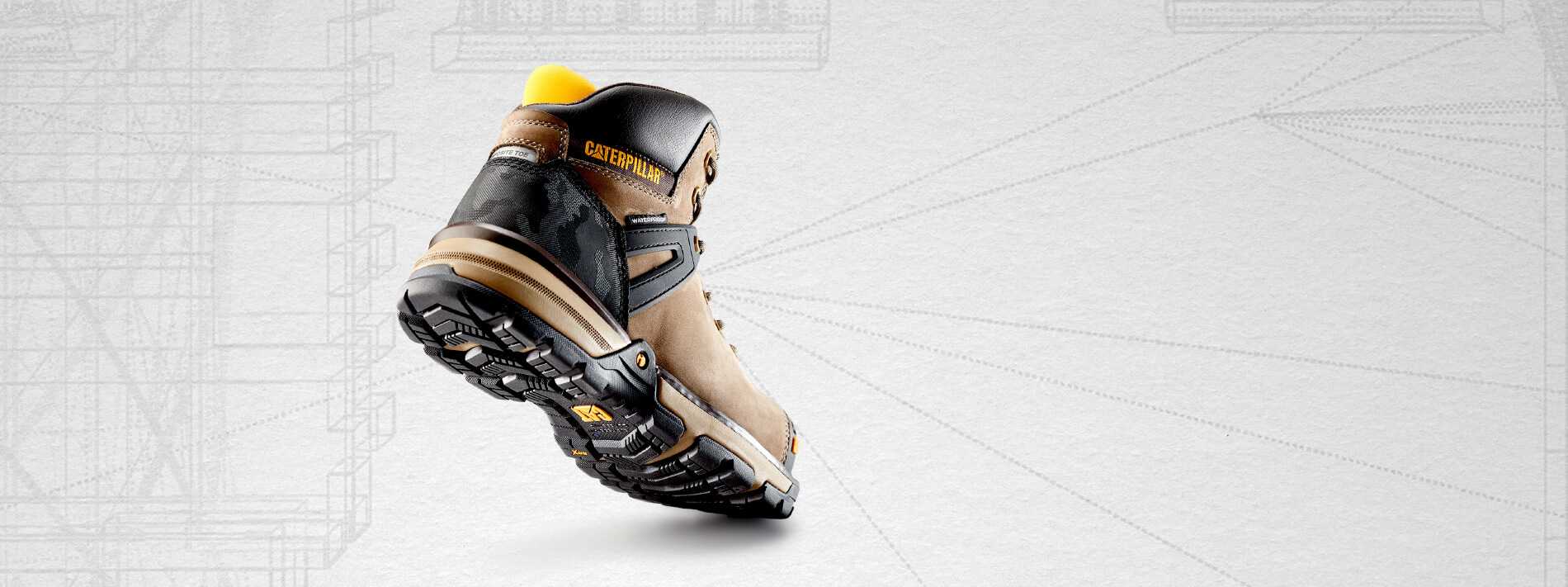 Tan, black and yellow Excavator boot.