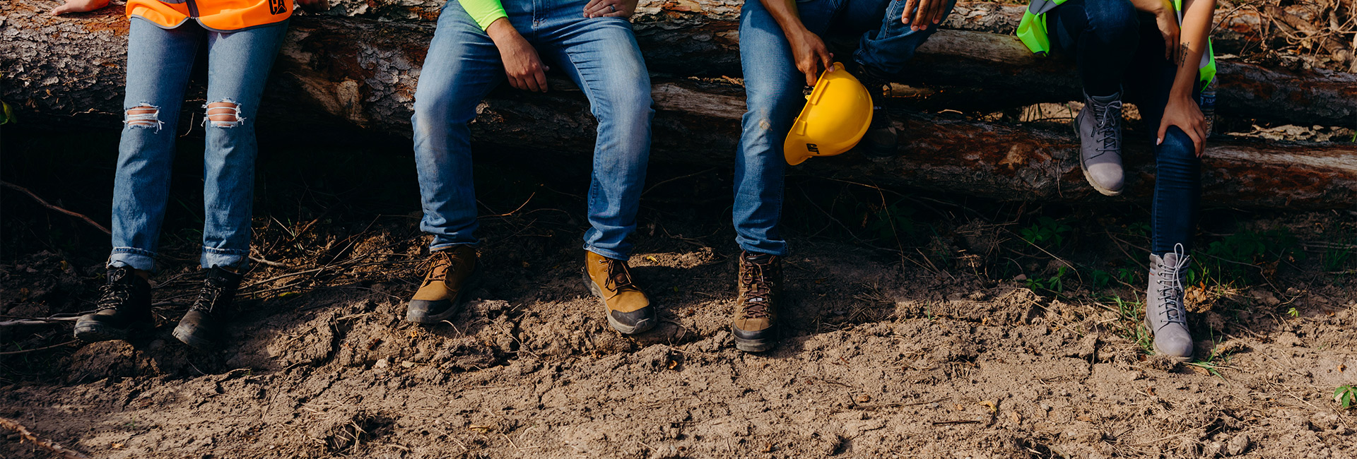 Group of workers on break all wearing CAT workboots.