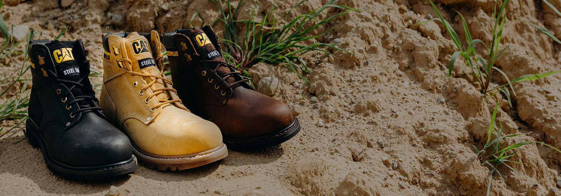 CAT Second Shift Boots sitting in the sand