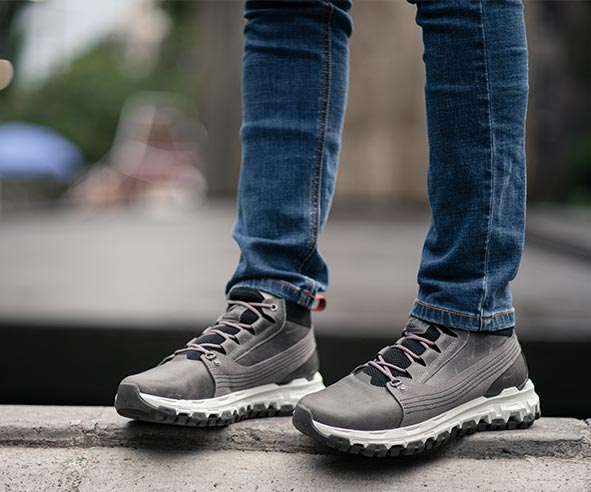 A person wearing their grey advanced walking machines.