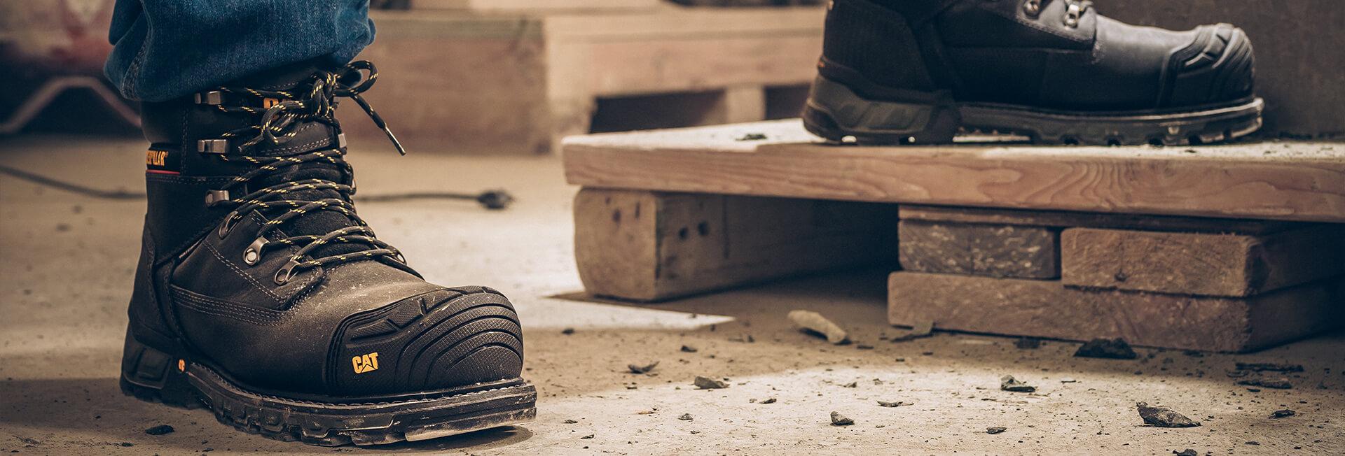 Feet in boots, stood on bricks.