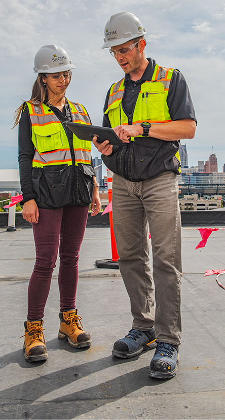 Man and Woman looking at an tablet on the job site.