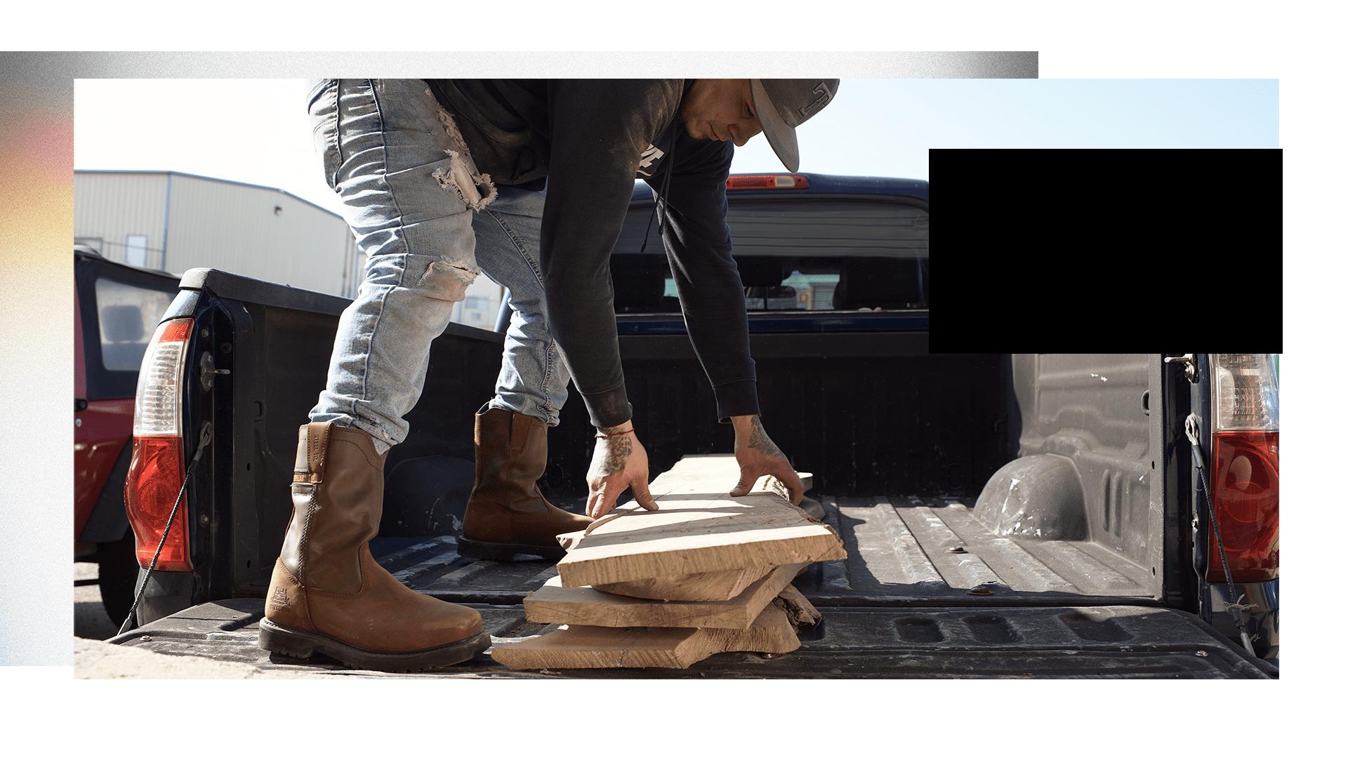 Man Picking up Lumber